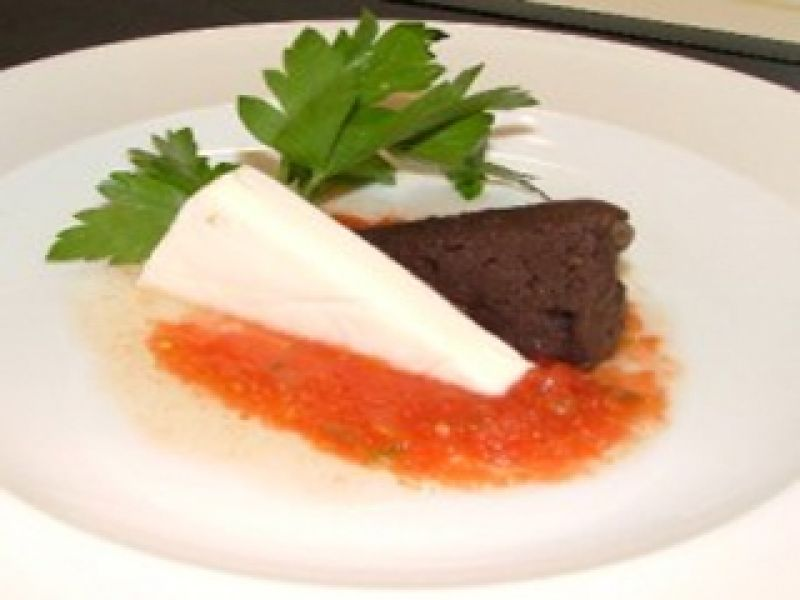 Black Bean Puree (refried) with Blanco Cheese and Tomato Sauce
